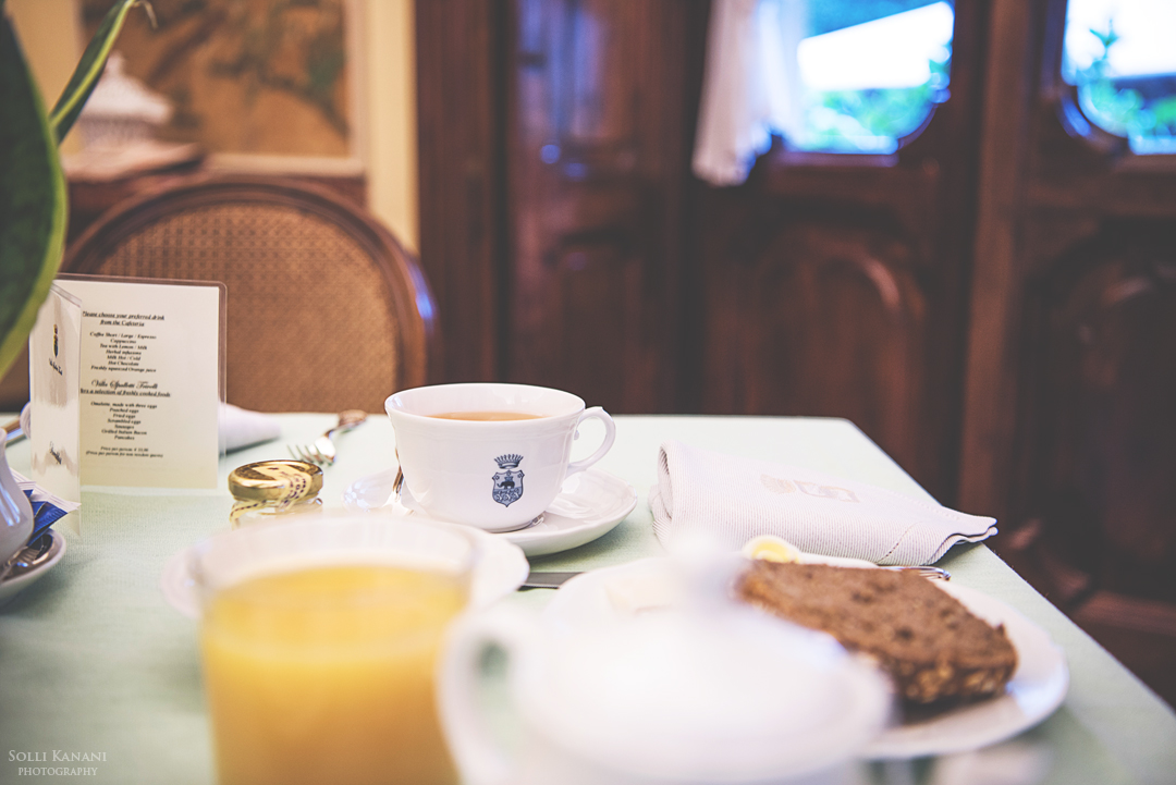 """A sumptiuous breakfast at Villa Spalletti Trivelli served in Sala da Pranzio """"Papier Paint"""" breakfast and dining room with a view over the secluded Italian garden"""